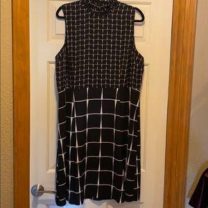 High neck. Sleeveless Dress